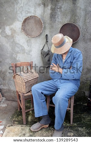 peasant sleeping in shabby  retro interior - stock photo