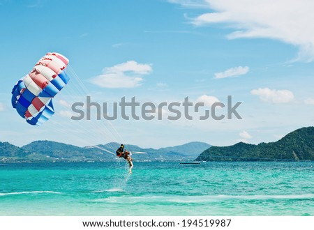 PEOPLE ARE PARASAILING in phuket - stock photo