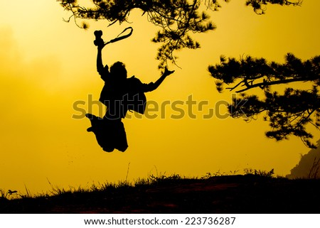 people jumping with silhouette in twilight time - stock photo