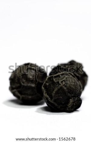 3 pepper corns - macro - stock photo