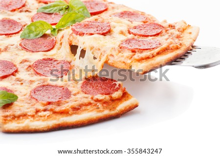 Pepperoni pizza beautiful arrangementOverhead studio shot of isolated Pepperoni pizza beautiful arrangement - stock photo