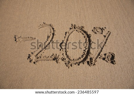 20 per cent discount in earth text written on brown sand ground low tide beach ocean seashore in Spain Europe - stock photo