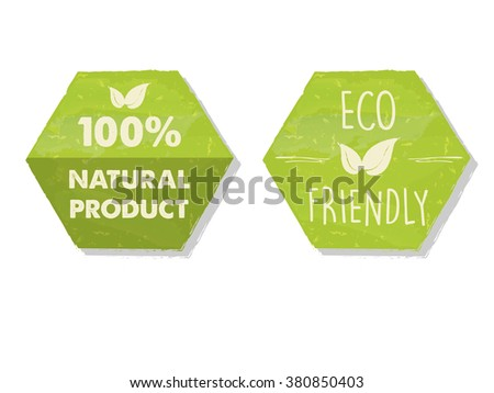 100 percent natural and eco friendly with leaf sign in green hexagons labels, bio ecology concept - stock photo