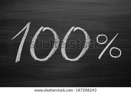 100-percent title written with a chalk on the blackboard - stock photo