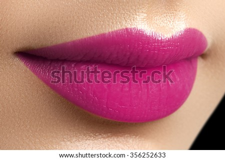 Perfect fuchsia lips. Sexy girl mouth close up. Beauty young woman smile. Fuchsia plump full Lips. Lips augmentation. Close up detail. Bright full lips - stock photo