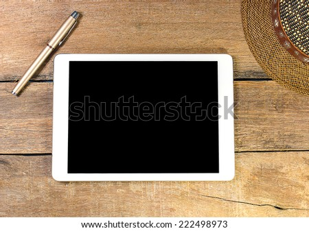phone and pen on wood background. - stock photo