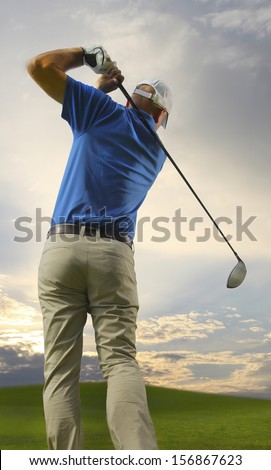 Photograph of a golfer finishing a full swing - stock photo