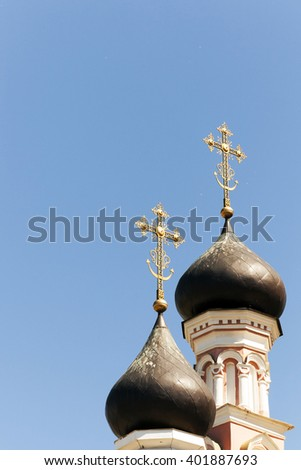 photographed by a dome with a cross Orthodox church located on the territory of the Republic of Belarus. the sky flies poplar fluff - stock photo