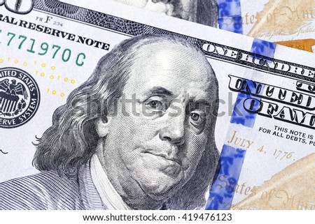 photographed close-up New American dollars put together - stock photo
