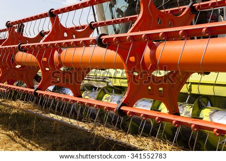 photographed close-up ply combine harvester. harvester after harvesting - stock photo