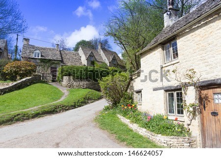 Picturesque, historic cottages in the Cotswolds tourist destination of Bibury,, Gloucestershire, UK. - stock photo