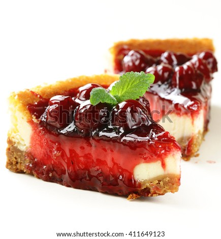 piece of cherry cheesecake and leaves of fresh mint - stock photo
