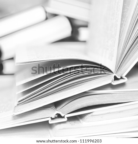 Pile of books in black and white - stock photo