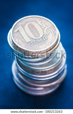 Pile of russian coins on a dark background. Toned image. Selective focus with shallow depth of field.  - stock photo