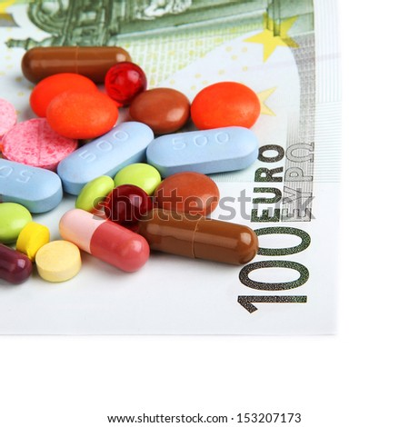 pills and 100 euro isolated on white - stock photo