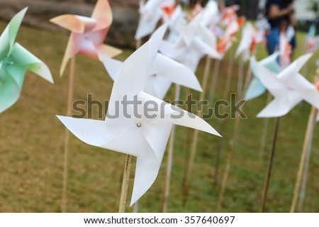pinwheel  in garden, many windmill concept of green energy wind farm in field , pinwheel toy. - stock photo