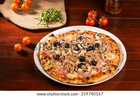 Pizza with chicken, cheese and olives - stock photo
