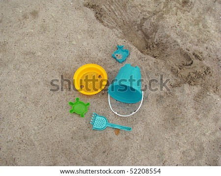 plastic play toys for at the beach - stock photo