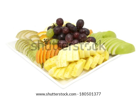 plate of fruit with exotic fruits on white background - stock photo