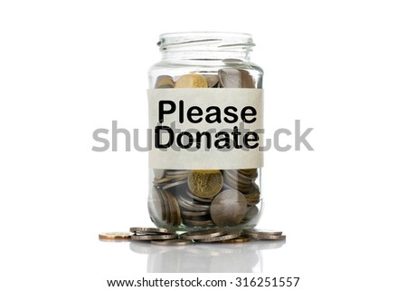 """Please Donate"" text label on full coins of jar spill out from it isolated on white background - saving, donation, financial, future investment and insurance concept - stock photo"