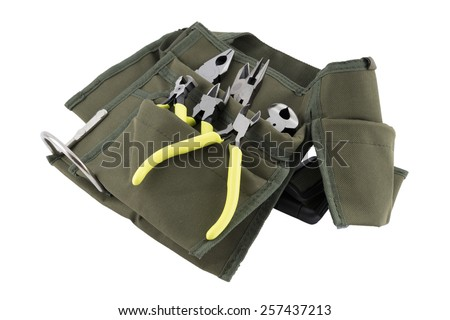 pliers green color to work  in tool Bag isolated on white background - stock photo