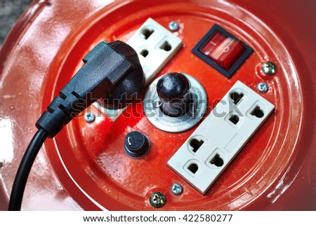plug is plugged into the power lines - stock photo