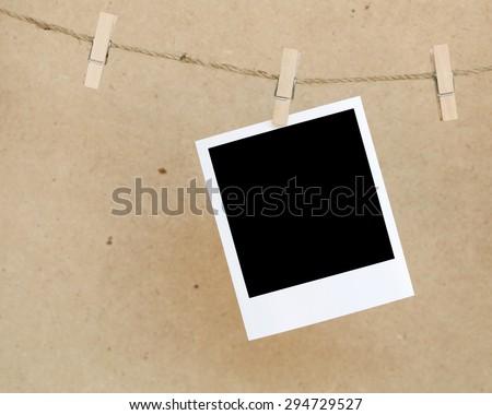polaroid film blanks hanging on a rope, polaroid frame. - stock photo