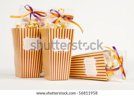 3 popcorn boxes with ribbon - stock photo