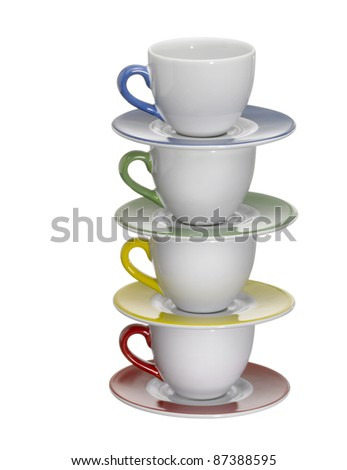 4 porcelain cups and saucers on each other, isolated on white with clipping path - stock photo