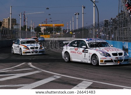 PORTO, PORTUGAL - JULY 8: A.priaulx of UK in his BMW participates in the FIA WORLD TOURING CAR CHAMPIONSHIP on July 8, 2007 in Porto, Portugal. - stock photo