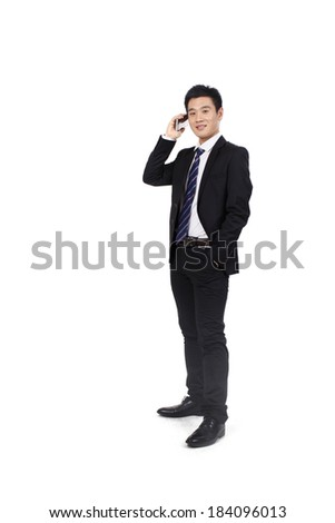 Portrait of a businessman standing with cell phone - stock photo