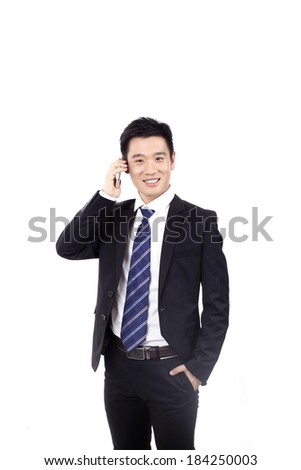 Portrait of a businessman standing with mobile phone - stock photo