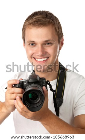 Portrait of a handsome young man holding a camera - stock photo