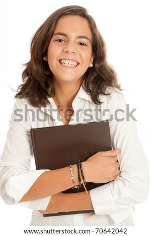 Portrait of a laughing young girl holding a book - stock photo