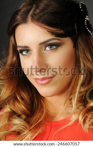 portrait of a Young caucasian girl with perfect clean skin and bright evening make up - stock photo