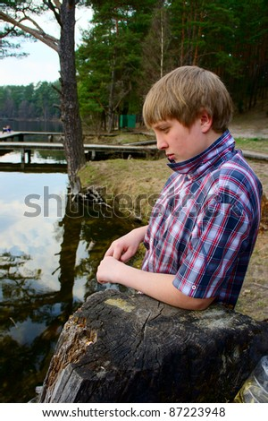 Portrait of a young man  on the lake - stock photo
