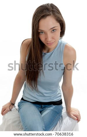 Portrait of an attractive brunette sitting down - stock photo