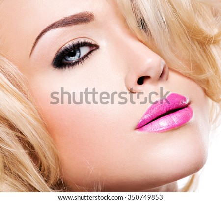 Portrait of fashion model with bright pink lips and black makeup of eye - stock photo