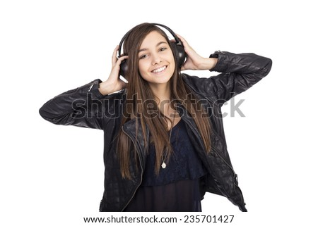 Portrait of happy cute  teenage girl  listening music on her headphones isolated on white background - stock photo