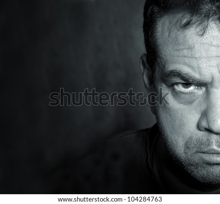 Portrait of male face half hidden in shadows - stock photo