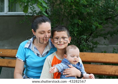 Portrait of mother and two sons - stock photo