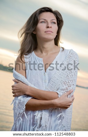 Portrait of the young sad woman - stock photo