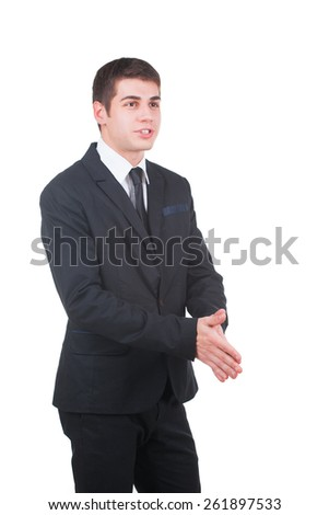 Portrait Of Young Businessman In A Suit shakes his hands isolated on white - stock photo