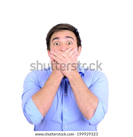 Portrait of young businessman making the speak no evil gesture isolated on white - stock photo