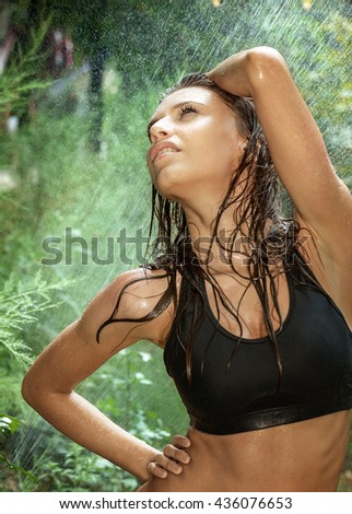 Portrait of young sexy woman in spray of water  - stock photo