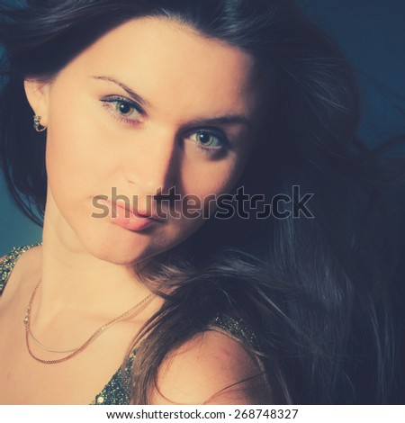 Portrait - Woman with Long Brown Hair. Instagram style filtred image - stock photo
