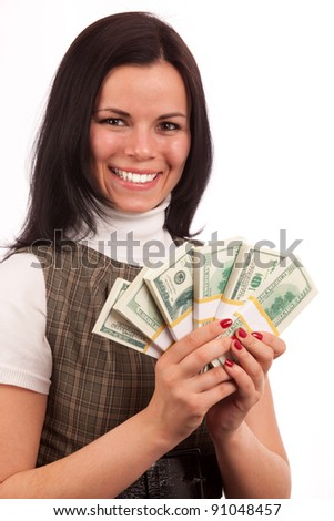 portreit of beautiful woman with bundles of American dollars on white background - stock photo
