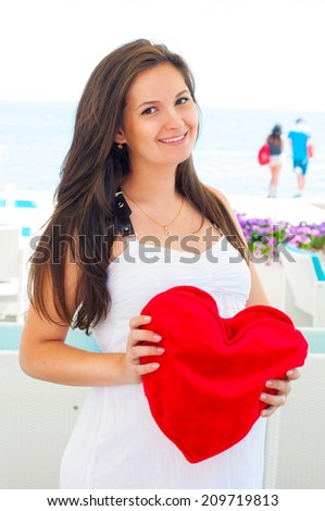 Pregnant Woman with red heart  - stock photo