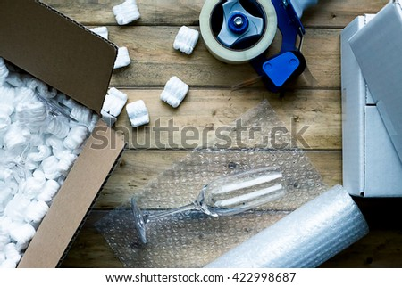 Preparing for moving. Packing, selling online, shipping, moving and lifestyle concept - stock photo