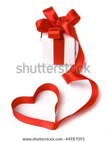 present box with red ribbon  in the form of hearts - stock photo